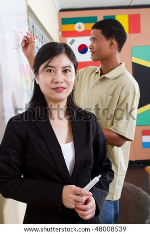 female chinese teacher portrait in classroom