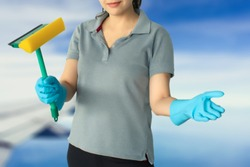 Female cleaning staff on sky and airplane blurred background Metaphor for cleaning Get rid of germs In bathroom, home office or industry.For reliability And satisfaction of service and customers.