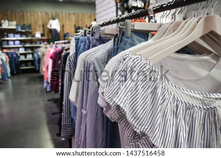 Female Clothes on Open Clothes Rail / Women clothing store