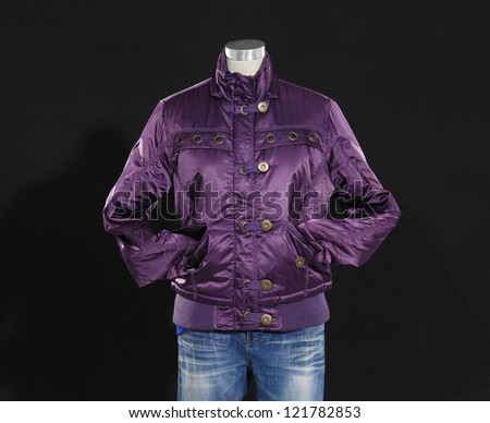 female clothing in jeans with coat mannequin-black background