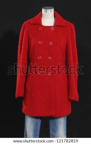 female clothing in jeans with red coat on mannequin
