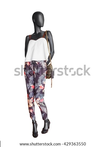 Shutterstock Female clothing on a mannequin with handbag on white background. No brand names or copyright objects.