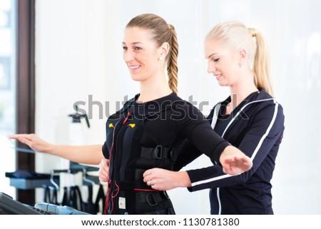 Female coach dress woman in ems electro muscular stimulation costume  #1130781380