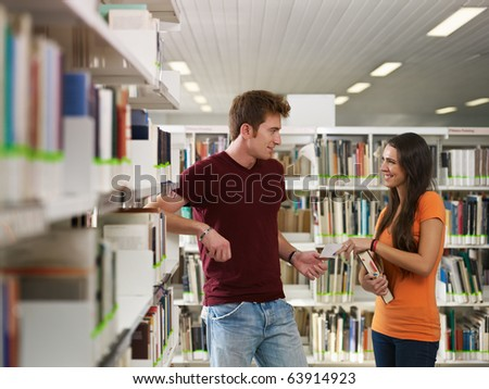 female college student giving phone number to her mate. Horizontal shape, side view, copy space - stock photo