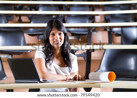 Female college student in university lecture room