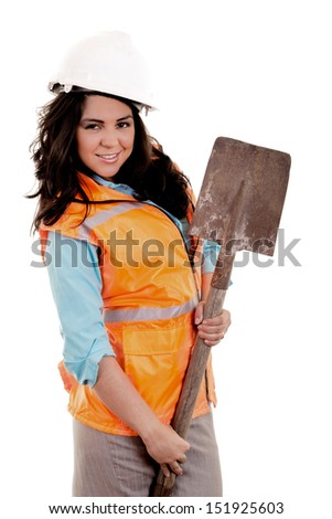 Female construction worker holding plans and spade - stock photo