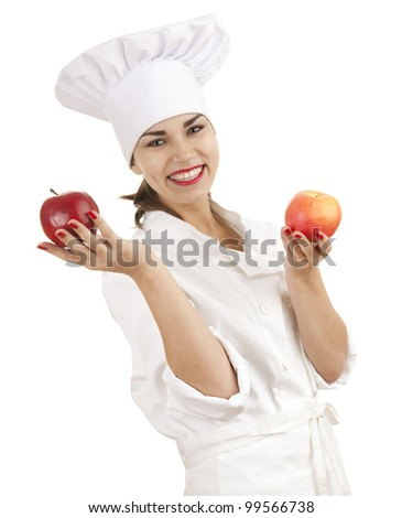 female cook in white uniform and hat with red apples, white background