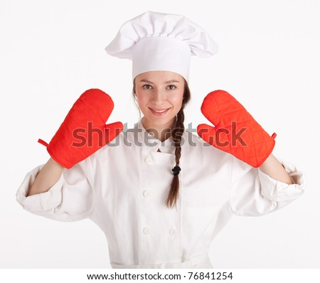 female cook in white uniform and hat with red kitchen gloves