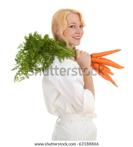 female cook in white uniform with bunch of carrots