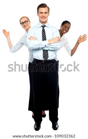Female corporate waving hi while man stands tall against white background