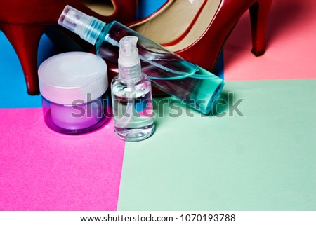 Female cream and body sprays on a bright colorful background #1070193788