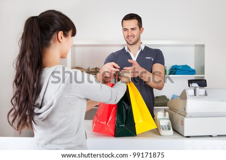 Female customer buying clothes at retail store