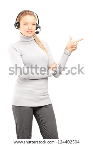 Female customer service operator with headphones pointing with finger isolated on white background