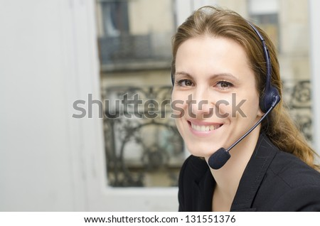 Female customer service representative at her desk - stock photo