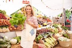 Female Customer Shopping At Farmers Market Stall
