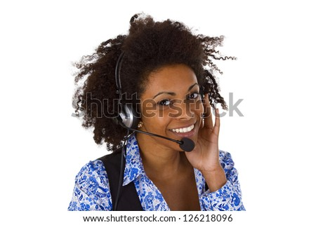 Female customer support operator with headset and smiling - isolated on white background