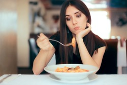 Female Customer Unhappy with the Dish Course in Restaurant. Depressed lonely woman suffering from appetite loss