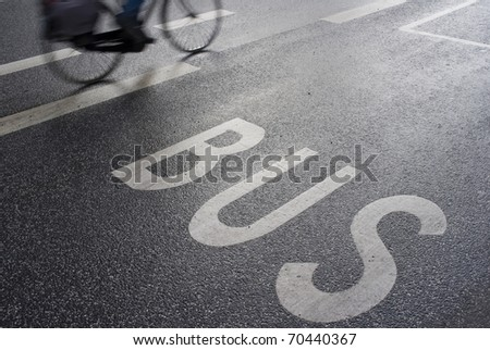 Female cyclist on her way to work. Motion blur. - stock photo