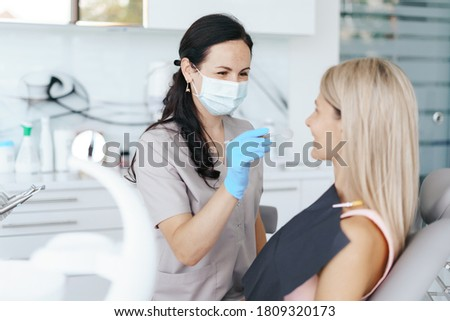 Female Dentist examine and discussing with happy patient about treatment Stock photo ©