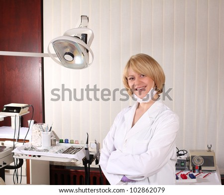 female dentist posing in ordination office