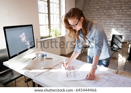 Female designer in office working on architects project #645444466