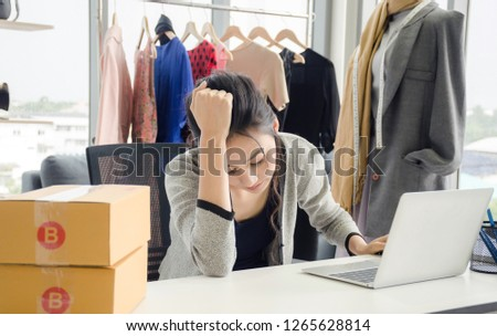 Female designer using laptop in office, shop onlie very famous for now aday. Wherever we stay we can buy product on internet and get by post. Stok fotoğraf ©