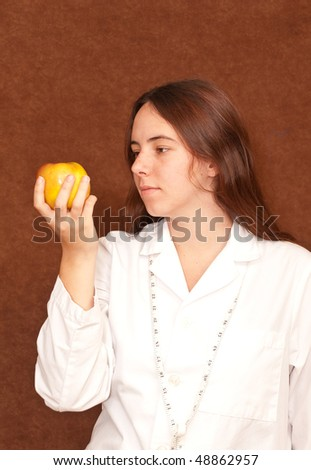 Female Dietitian with Apple and Tape Measure - stock photo
