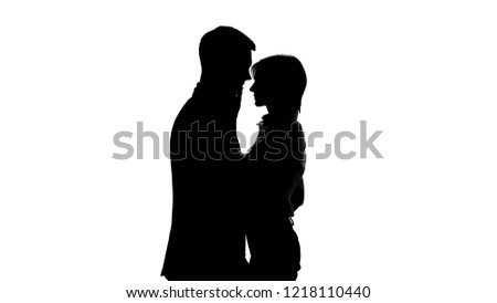 Female director shadow tenderly kissing her subordinate employee, office romance