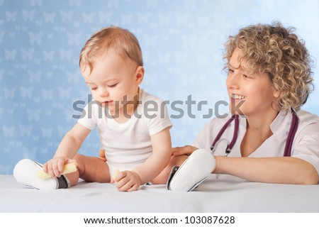 Female doctor and baby patient.