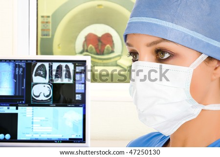 female doctor and computer tomographic scanner in hospital