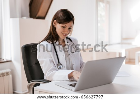 Female doctor at work using laptop #656627797