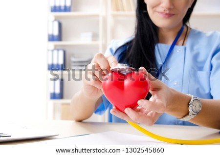Female doctor cardiologist working in the clinic #1302545860