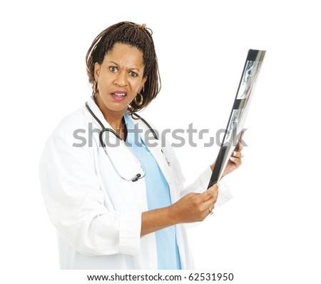 Female doctor confused by strange x-ray results.  Isolated on white.