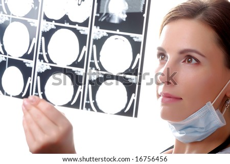 Female doctor examining a x ray