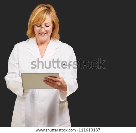 female doctor holding digital tablet isolated on black background