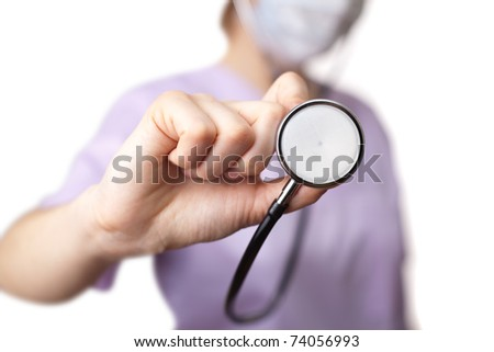 Female doctor holding stethoscope pointed toward camera. selective focus
