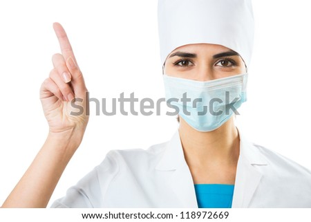 Female doctor in a mask shows on a white background