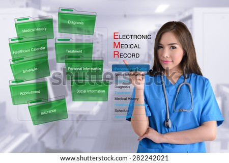 Female doctor in blue uniform show how electronic medical record work.