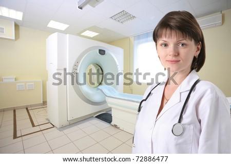 Female doctor in CT Scanner room