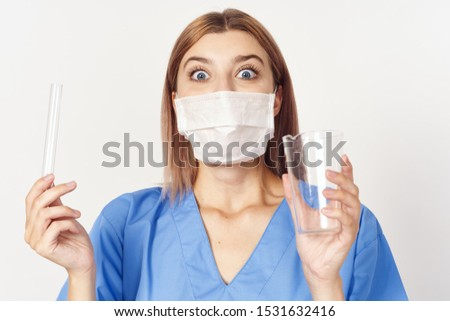 female doctor in medical coat and face mask laboratory scientific research vessels vessels #1531632416