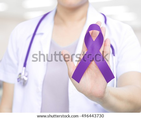Female doctor in white uniform with purple awareness of ribbon in hand for ADD,ADHD,Alzheimer's Disease ,Arnold Chiari Malformation,Childhood Hemiplegia & stroke, Epilepsy, Chronic & Acute Pain,Crohns Stock fotó ©