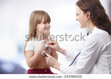 Female doctor listening heart break of preschool child at private clinic.