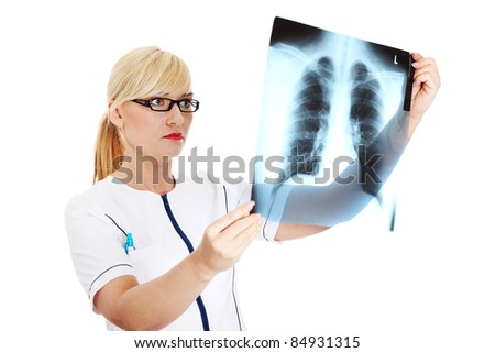 Female doctor looking at an x-ray, isolated on white