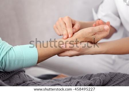 Female doctor measuring pulse #458495227