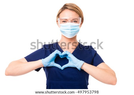 Female Doctor Nurse dental hygienist making heart shape over her heart isolated on white background for use alone or as a design element Stock photo ©