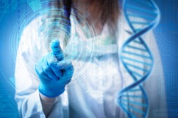 Female doctor or nurse touching futuristic hologram screen.  Genetic, medicine and innovative technologies concept.