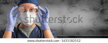 Female Doctor or Nurse Wearing Scrubs and Protective Mask and Goggles Banner.