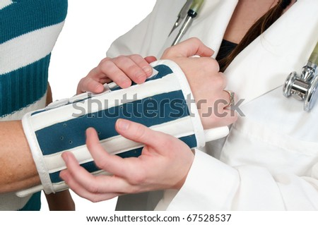 Female doctor putting an arm brace on a the arm of a woman