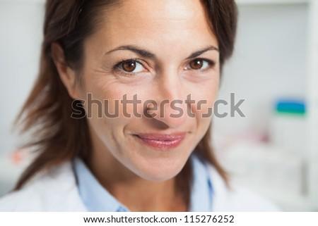 Female doctor smiling - stock photo
