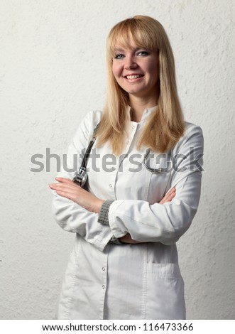 Female doctor smiling on the white background.